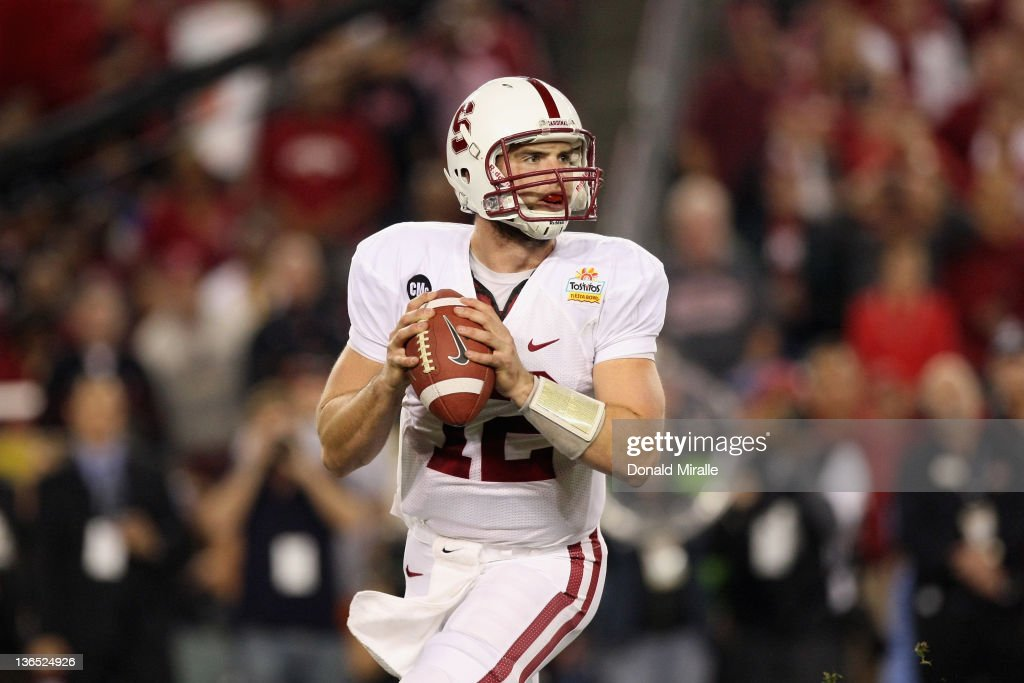 Quarterback <a gi-track='captionPersonalityLinkClicked' href=/galleries/search?phrase=Andrew+Luck&family=editorial&specificpeople=6258221 ng-click='$event.stopPropagation()'>Andrew Luck</a> #12 of the Stanford Cardinal looks to pass against the Oklahoma State Cowboys during the Tostitos Fiesta Bowl on January 2, 2012 at University of Phoenix Stadium in Glendale, Arizona.
