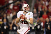 Quarterback Andrew Luck of the Stanford Cardinal looks to pass against the Oklahoma State Cowboys during the Tostitos Fiesta Bowl on January 2 2012...