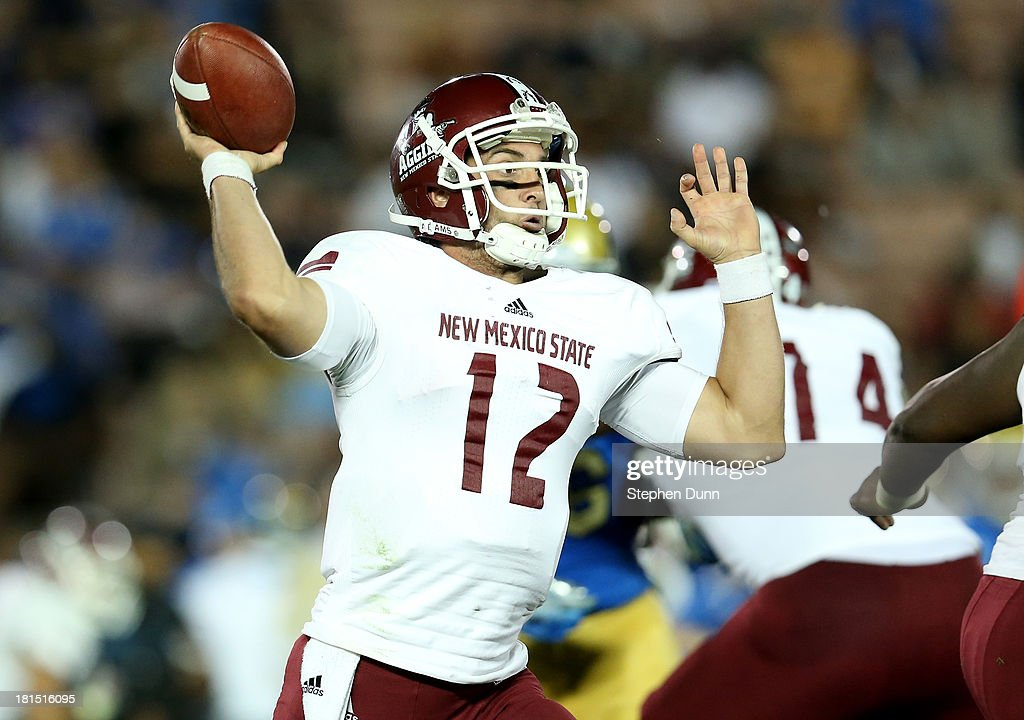 Quarterback Andrew McDonald #12 of the New Mexico State Aggies throws a pass against the UCLA Bruins at the Rose Bowl on September 21, 2013 in Pasadena, California. UCLA won 59-13.