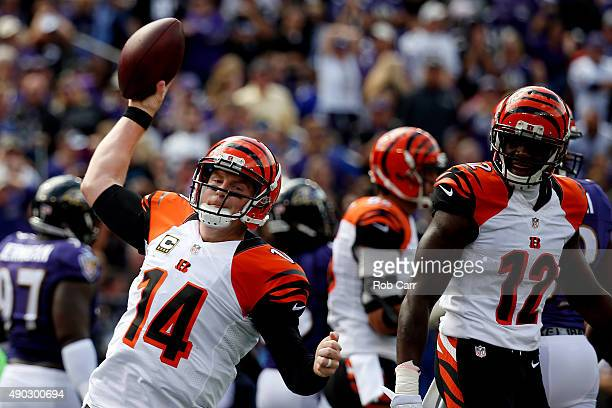 Quarterback Andy Dalton of the Cincinnati Bengals celebrates with wide receiver Mohamed Sanu of the Cincinnati Bengals after scoring a first quarter...