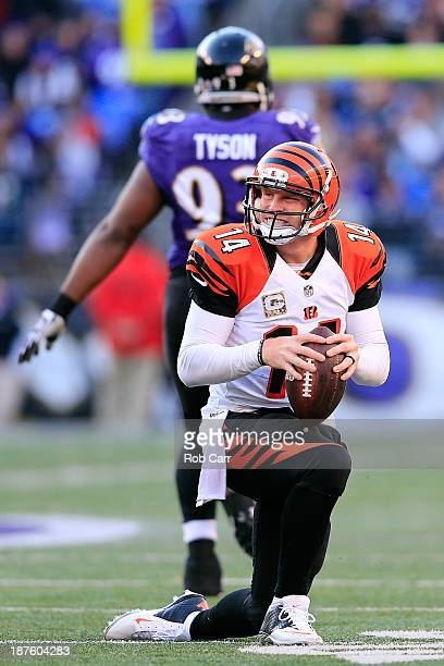 Quarterback Andy Dalton of the Cincinnati Bengals gets up after being sacked by defensive end DeAngelo Tyson of the Baltimore Ravens during the...