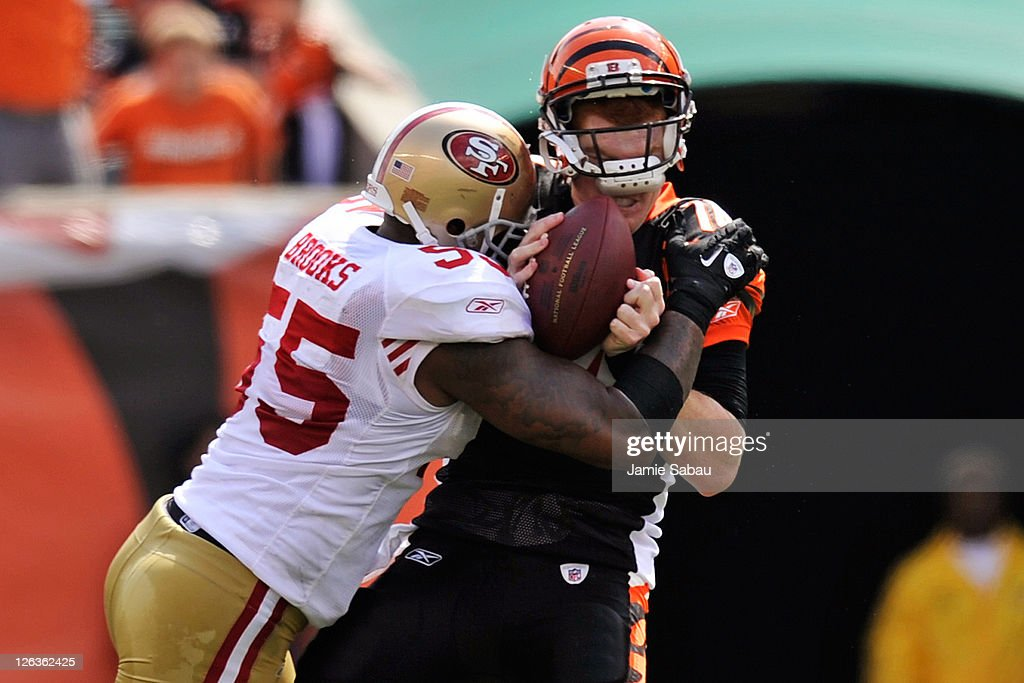 Quarterback Andy Dalton of the Cincinnati Bengals is sacked for a loss by Ahmad Brooks of the San Francisco 49ers at Paul Brown Stadium on September...