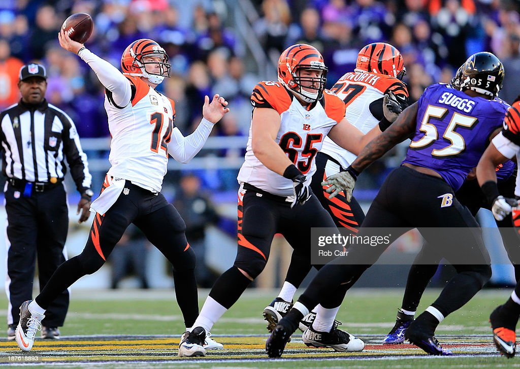 Quarterback <a gi-track='captionPersonalityLinkClicked' href=/galleries/search?phrase=Andy+Dalton+-+American+Football+Player&family=editorial&specificpeople=15271549 ng-click='$event.stopPropagation()'>Andy Dalton</a> #14 of the Cincinnati Bengals throws a pass against the Baltimore Ravens at M&T Bank Stadium on November 10, 2013 in Baltimore, Maryland.