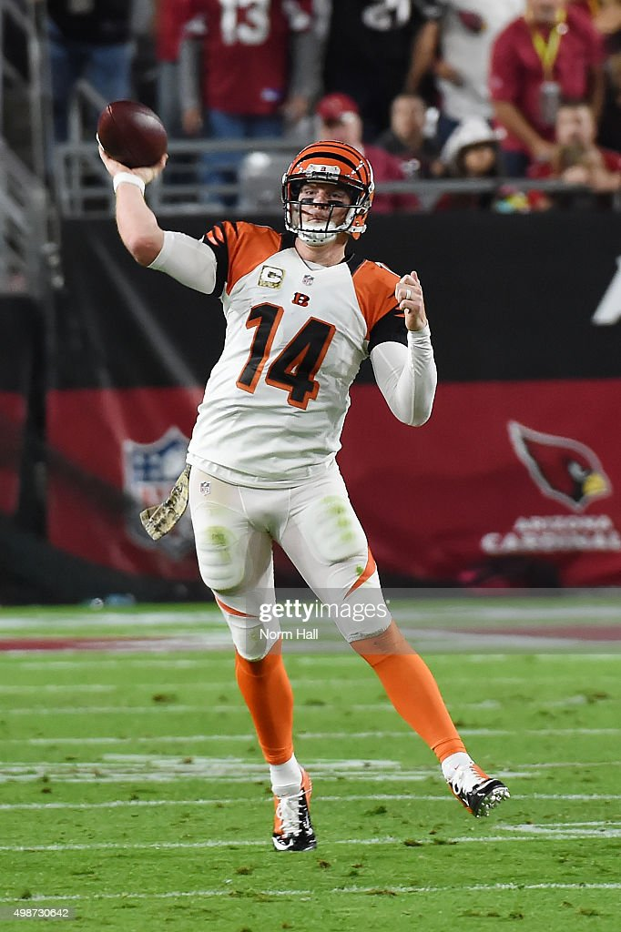 Quarterback Andy Dalton of the Cincinnati Bengals throws the ball down field against the Arizona Cardinals at University of Phoenix Stadium on...