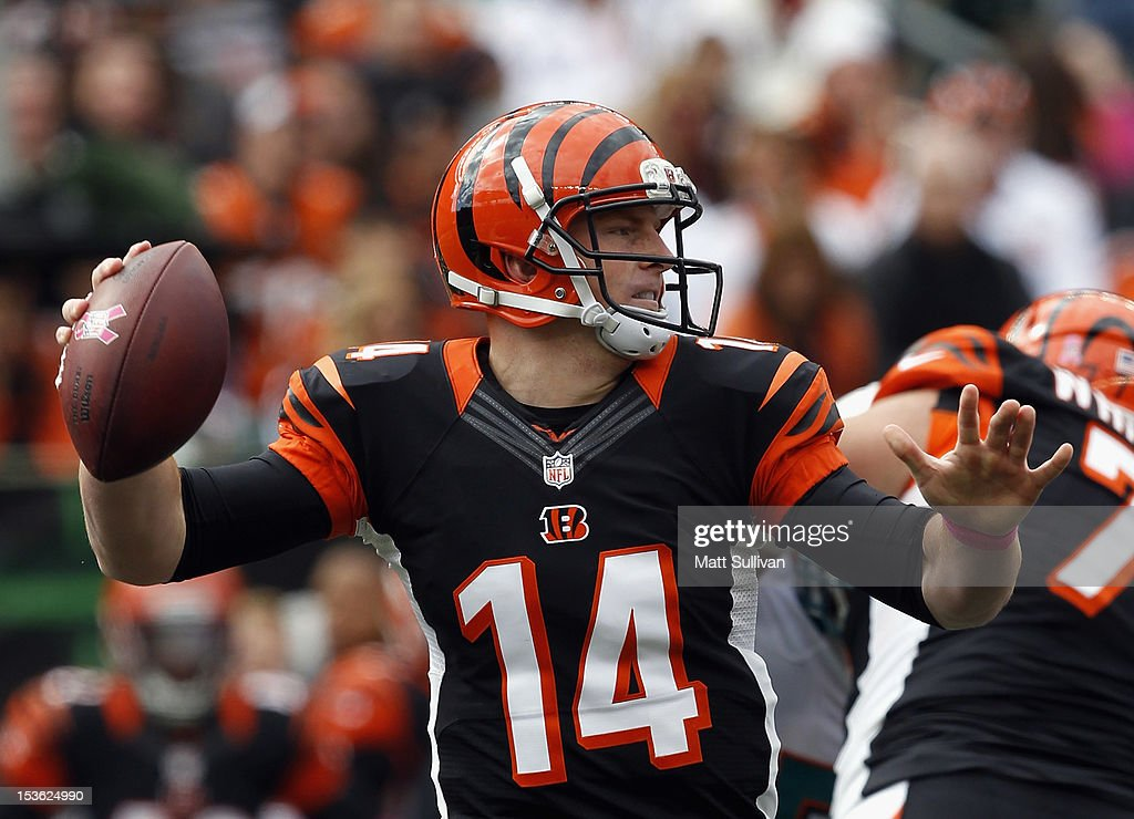 Quarterback <a gi-track='captionPersonalityLinkClicked' href=/galleries/search?phrase=Andy+Dalton+-+American+Football+Player&family=editorial&specificpeople=15271549 ng-click='$event.stopPropagation()'>Andy Dalton</a> #14 of the Cincinnati Bengals throws to a receiver against the Miami Dolphins at Paul Brown Stadium on October 7, 2012 in Cincinnati, Ohio.
