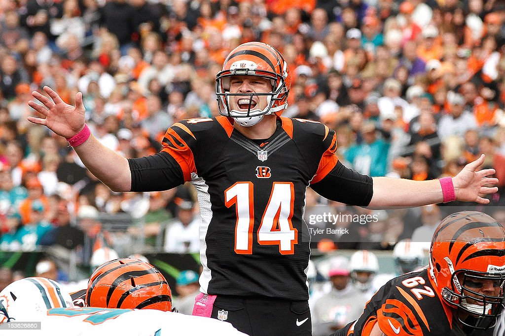 Quarterback <a gi-track='captionPersonalityLinkClicked' href=/galleries/search?phrase=Andy+Dalton+-+American+Football+Player&family=editorial&specificpeople=15271549 ng-click='$event.stopPropagation()'>Andy Dalton</a> #14 of the Cincinnati Bengals, yells to his offensive line before the start of a play during the game against the Miami Dolphins at Paul Brown Stadium on October 7, 2012 in Cincinnati, Ohio.