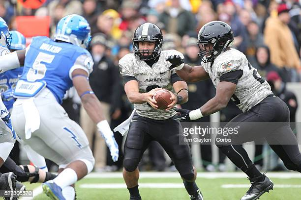 Quarterback Angel Santiago Army fakes hand off during the Army Black Knights Vs Air Force Falcons College Football match at Michie Stadium West Point...