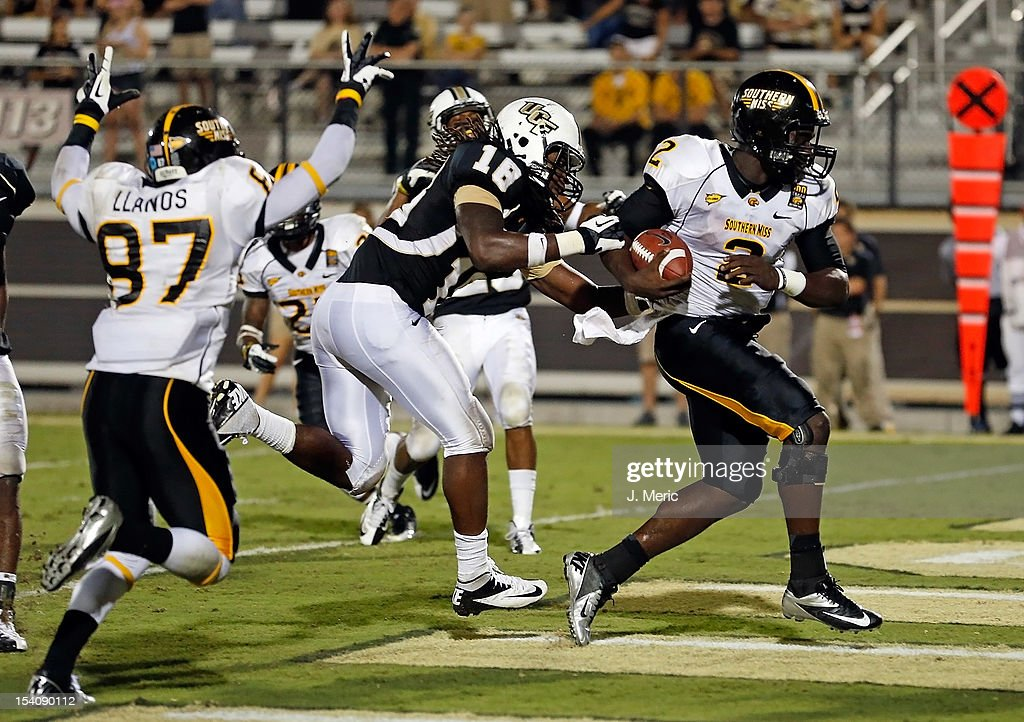 Quarterback Anthony Alford of the Southern Mississippi Golden Eagles scores a touchdown in the first overtime against the Central Florida Knights...