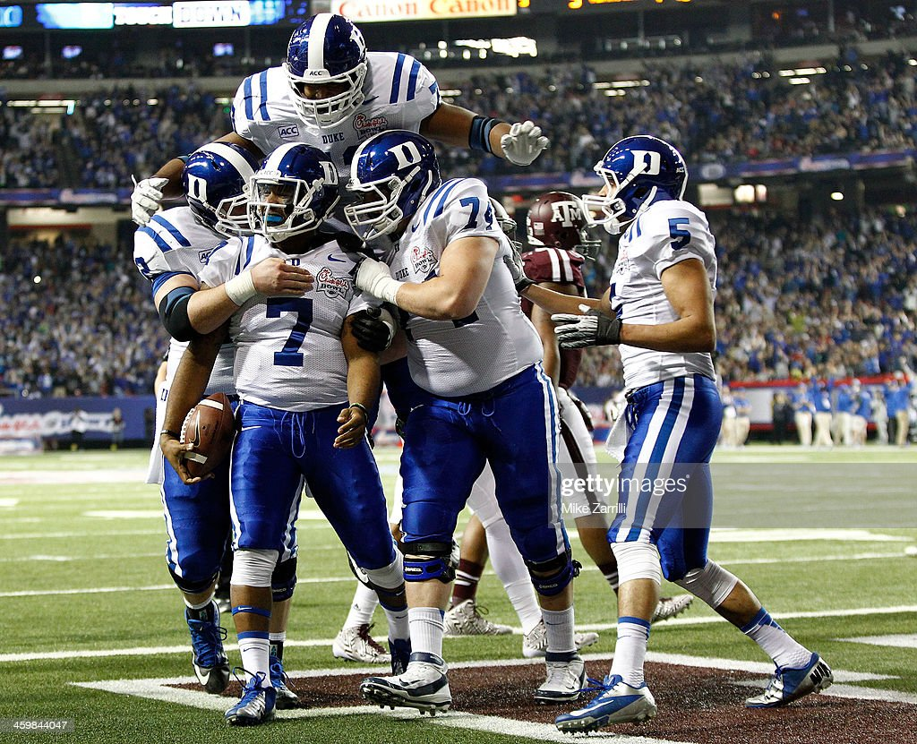 Quarterback Anthony Boone #7 of the Duke Blue Devils celebrates with teammates after scoring a touchdown during the Chick-fil-A Bowl game against the Texas A&M Aggies at the Georgia Dome on December 31, 2013 in Atlanta, Georgia.