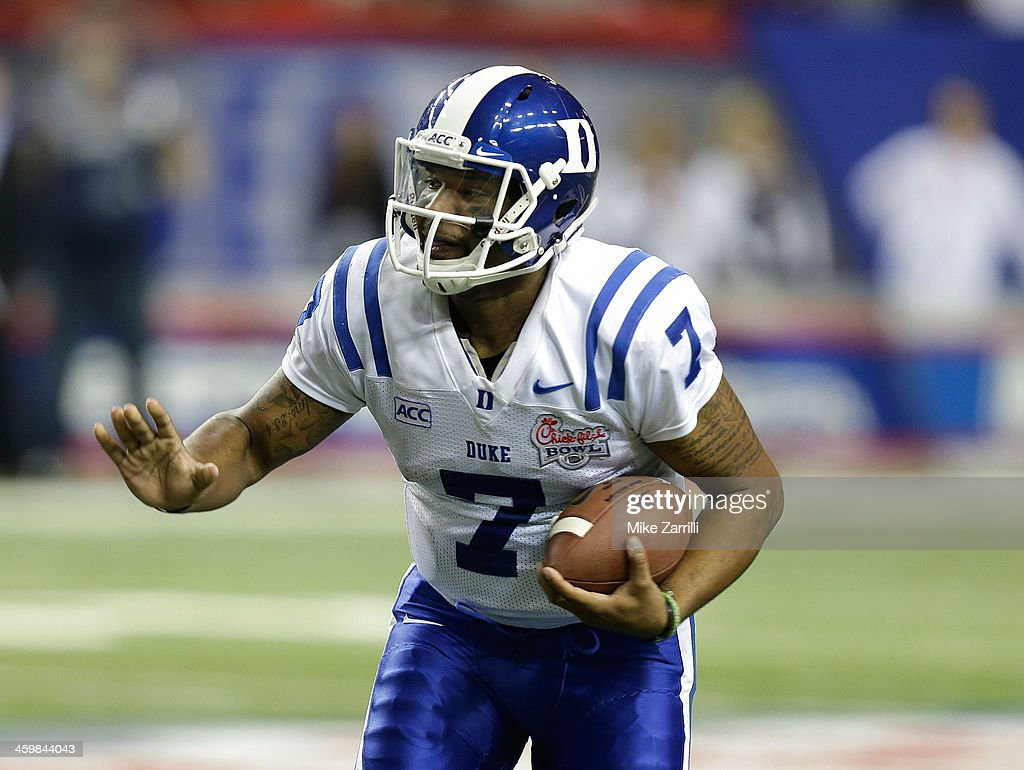 Quarterback Anthony Boone #7 of the Duke Blue Devils rushes for yardage during the Chick-fil-A Bowl game against the Texas A&M Aggies at the Georgia Dome on December 31, 2013 in Atlanta, Georgia.