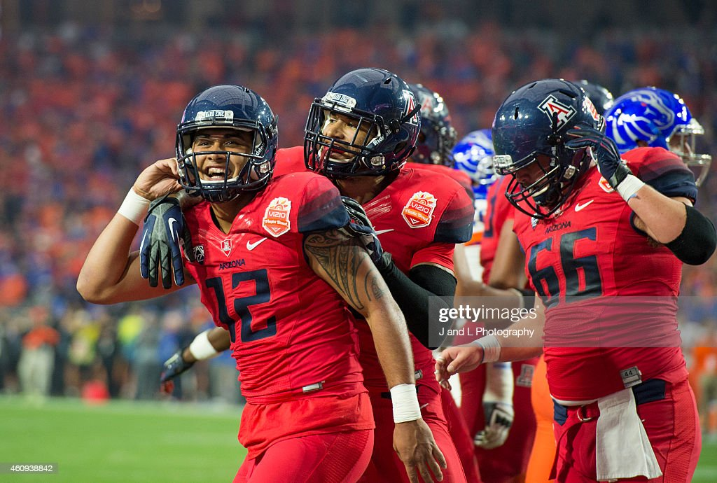 Quarterback Anu Solomon #12 of the Arizona Wildcats celebrates his one yard touchdown run against the Boise State Broncos in the Vizio Fiesta Bowl at the University of Phoenix Stadium on December 31, 2014 in Glendale, Arizona.