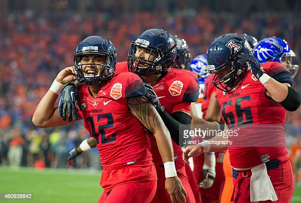Quarterback Anu Solomon of the Arizona Wildcats celebrates his one yard touchdown run against the Boise State Broncos in the Vizio Fiesta Bowl at the...