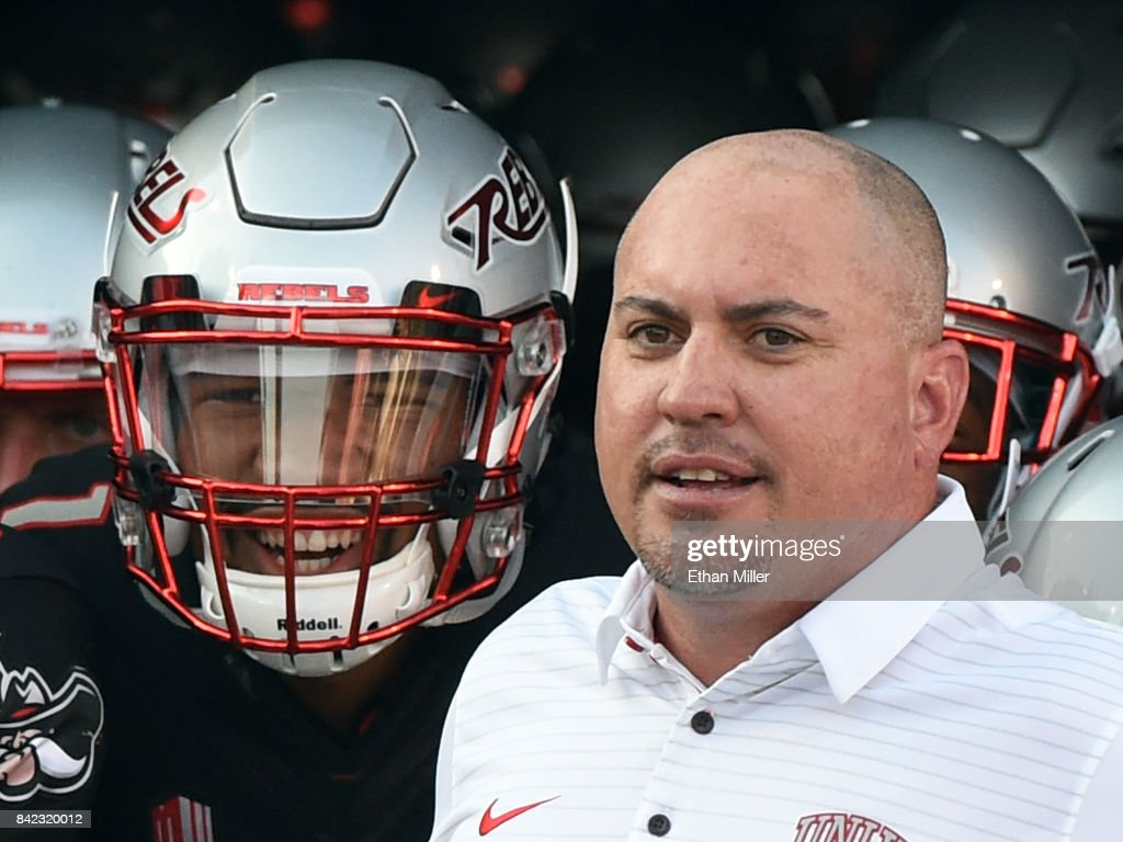 Quarterback Armani Rogers #1 and head coach Tony Sanchez of the UNLV Rebels prepare to take the field before their game against the Howard Bison at Sam Boyd Stadium on September 2, 2017 in Las Vegas, Nevada. Howard won 43-40.