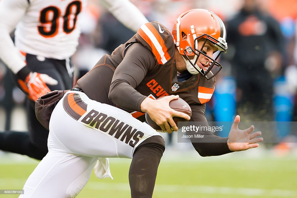 Quarterback Austin Davis #7 of the Cleveland Browns dives for a first down against the Cincinnati Bengals during the second half at FirstEnergy Stadium on December 6, 2015 in Cleveland, Ohio. The Bengals defeated the Browns 37-3.