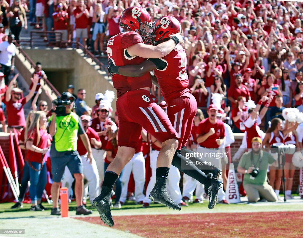 Quarterback Baker Mayfield #6 and wide receiver Marquise Brown #5 of the Oklahoma Sooners celebrate Mayfield's touchdown against the Iowa State Cyclones at Gaylord Family Oklahoma Memorial Stadium on October 7, 2017 in Norman, Oklahoma.