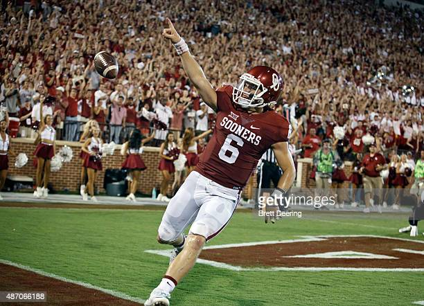 Quarterback Baker Mayfield of the Oklahoma Sooners celebrates a touchdown against the Akron Zips September 5 2015 at Gaylord FamilyOklahoma Memorial...