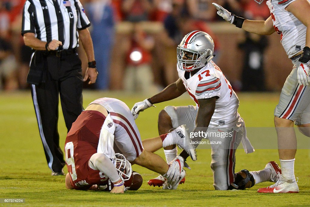 Quarterback Baker Mayfield #6 of the Oklahoma Sooners is tackled after trying to scramble for a first down by linebacker Jerome Baker #17 of the Ohio State Buckeyes on September 17, 2016 at Gaylord Family Oklahoma Memorial Stadium in Norman, Oklahoma.