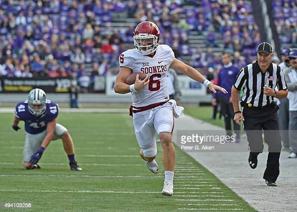 Quarterback Baker Mayfield of the Oklahoma Sooners runs down the sideline against the Kansas State Wildcats during the second half on October 17 2015...