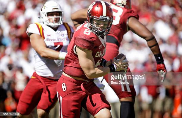 Quarterback Baker Mayfield of the Oklahoma Sooners scrambles against the Iowa State Cyclones at Gaylord Family Oklahoma Memorial Stadium on October 7...