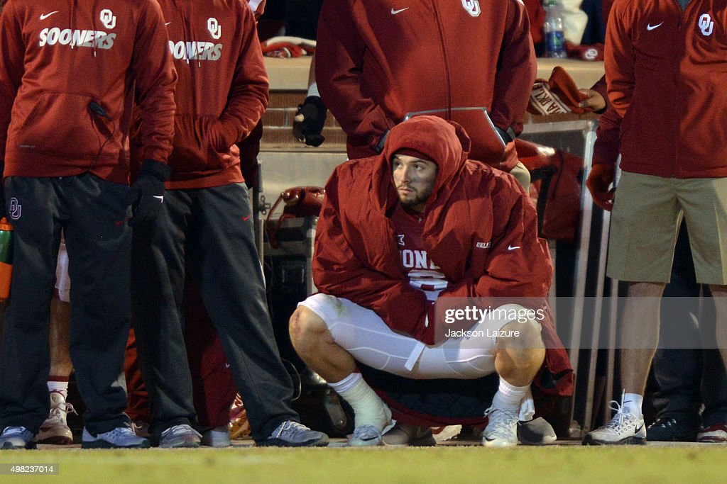 Quarterback Baker Mayfield # 6 of the Oklahoma Sooners watches game action while sitting out the second half during their win against the TCU Horned Frogs on November 21, 2015 at the Gaylord Family Oklahoma Memorial Stadium in Norman, Oklahoma.