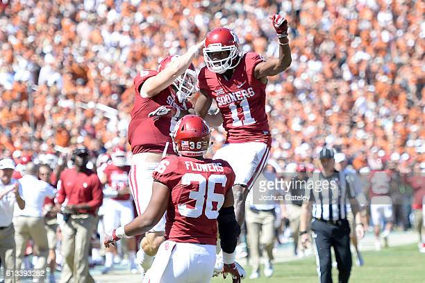 Quarterback Baker Mayfield wide receiver Dede Westbrook and fullback Dimitri Flowers of the Oklahoma Sooners celebrate a second half touchdown...