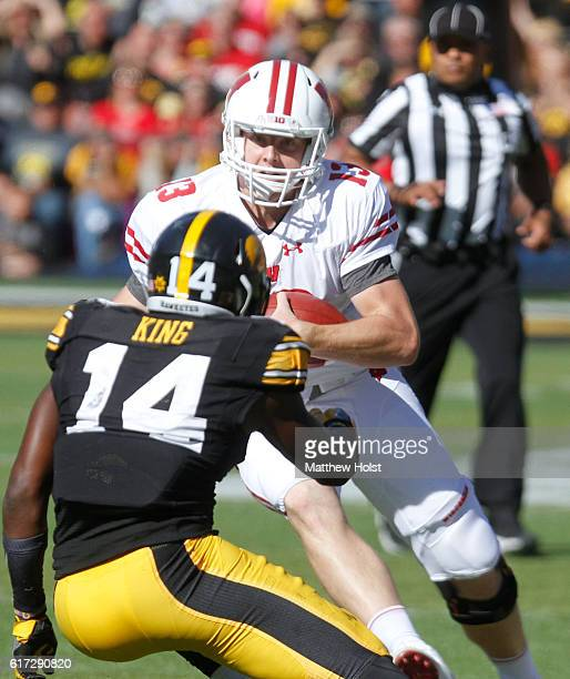 Quarterback Bart Houston of the Wisconsin Badgers runs up the field against defensive back Desmond King of the Iowa Hawkeyes in the fourth quarter on...