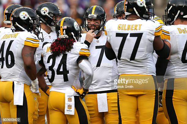 Quarterback Ben Roethlisberger of the Pittsburgh Steelers adjusts his helmet in the huddle before taking a snap against the Baltimore Ravens in the...