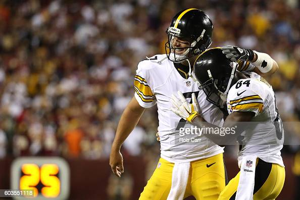 Quarterback Ben Roethlisberger of the Pittsburgh Steelers celebrates with teammate wide receiver Antonio Brown after a fourth quarter touchdown...
