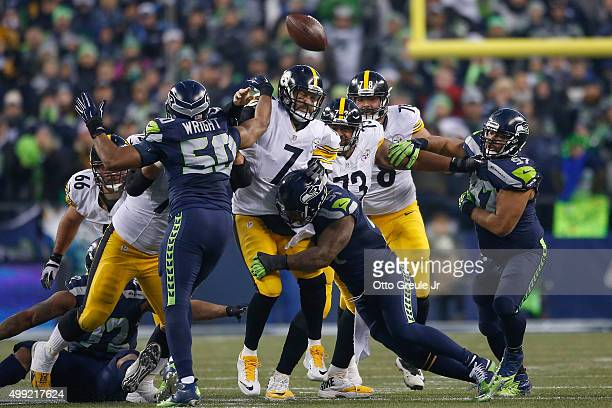 Quarterback Ben Roethlisberger of the Pittsburgh Steelers is hit by linebacker Bruce Irvin as he passes against the Seattle Seahawks at CenturyLink...