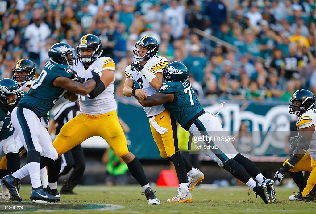 Quarterback Ben Roethlisberger #7 of the Pittsburgh Steelers is hit by Vinny Curry #75 of the Philadelphia Eagles just after throwing an incomplete pass in the third quarter at Lincoln Financial Field on September 25, 2016 in Philadelphia, Pennsylvania.