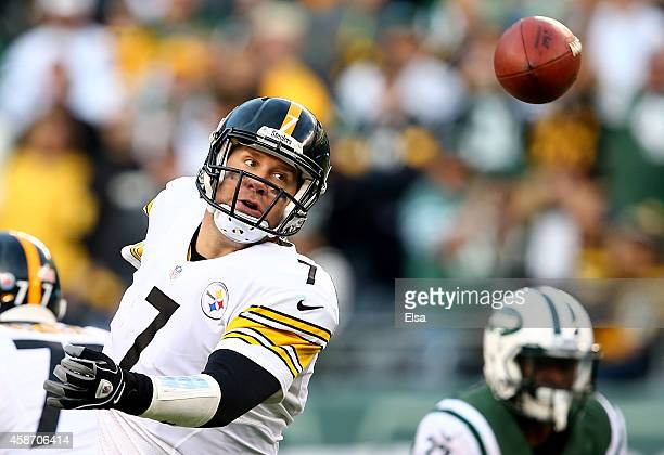 Quarterback Ben Roethlisberger of the Pittsburgh Steelers loses control of a bad snap against the New York Jets during a game at MetLife Stadium on...