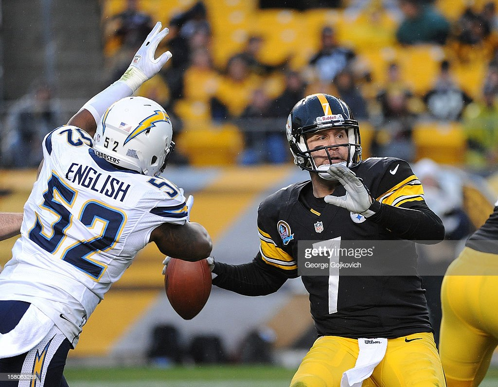 Quarterback Ben Roethlisberger #7 of the Pittsburgh Steelers passes while under pressure from linebacker Larry English #52 of the San Diego Chargers during a game at Heinz Field on December 9, 2012 in Pittsburgh, Pennsylvania. The Chargers defeated the Steelers 34-24.