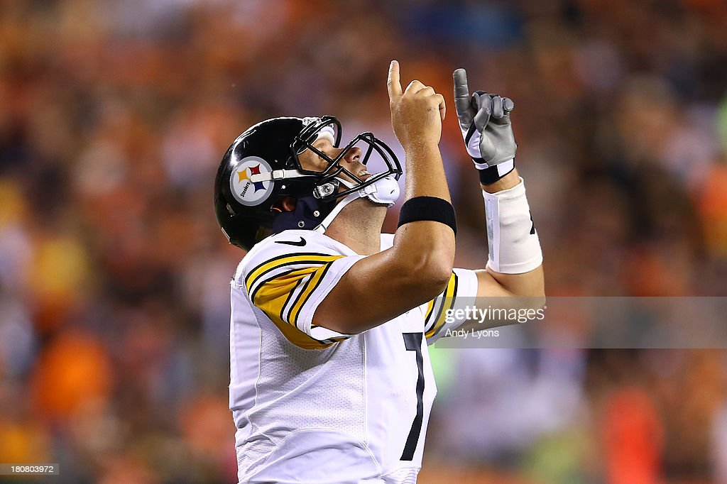 Quarterback <a gi-track='captionPersonalityLinkClicked' href=/galleries/search?phrase=Ben+Roethlisberger&family=editorial&specificpeople=201605 ng-click='$event.stopPropagation()'>Ben Roethlisberger</a> #7 of the Pittsburgh Steelers reacts after throwing a one-yard touchdown pass against the Cincinnati Bengals at Paul Brown Stadium on September 16, 2013 in Cincinnati, Ohio.