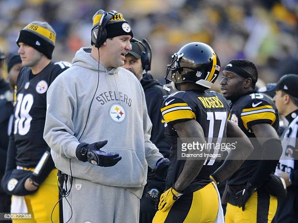 Quarterback Ben Roethlisberger of the Pittsburgh Steelers talks with wide receivers Eli Rogers and Demarcus Ayers on the sideline during a game...