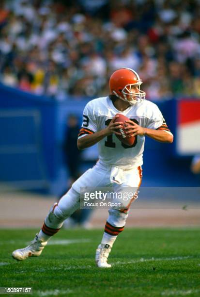 Quarterback Bernie Kosar of the Cleveland Brown drops back to pass against the Houston Oilers during an NFL football game at Cleveland Municipal...