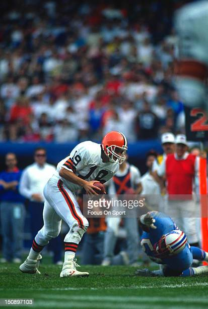 Quarterback Bernie Kosar of the Cleveland Brown in action against the Houston Oilers during an NFL football game at Cleveland Municipal Stadium circa...
