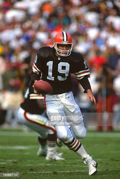 Quarterback Bernie Kosar of the Cleveland Brown runs with the ball against the Washington Redskins during an NFL football game at RFK Stadium October...
