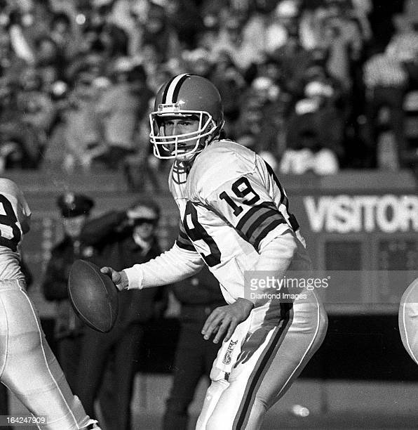 Quarterback Bernie Kosar of the Cleveland Browns looks for an open receiver during a game against the Detroit Lions on Sunday September 28 1986 at...