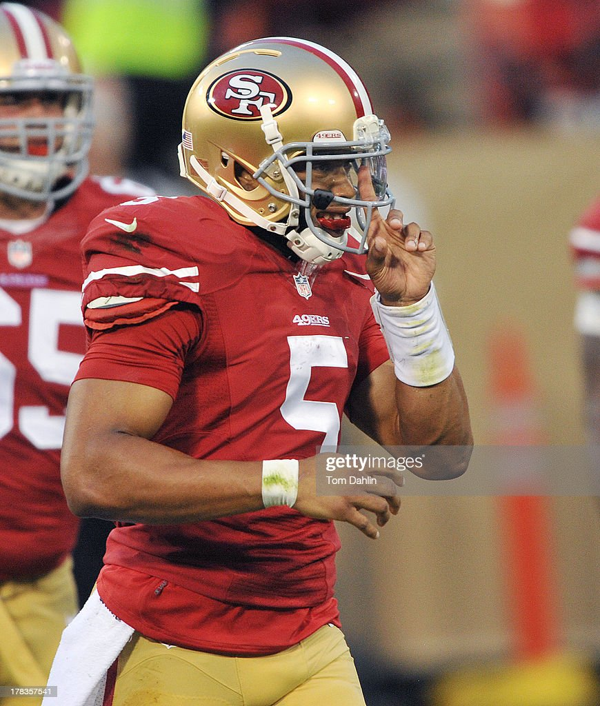 Quarterback B.J. Daniels #5 of the San Francisco 49ers adjusts his face mask during a NFL game against the Minnesota Vikings, August 25, 2013, at Candlestick Park in San Francisco, California.