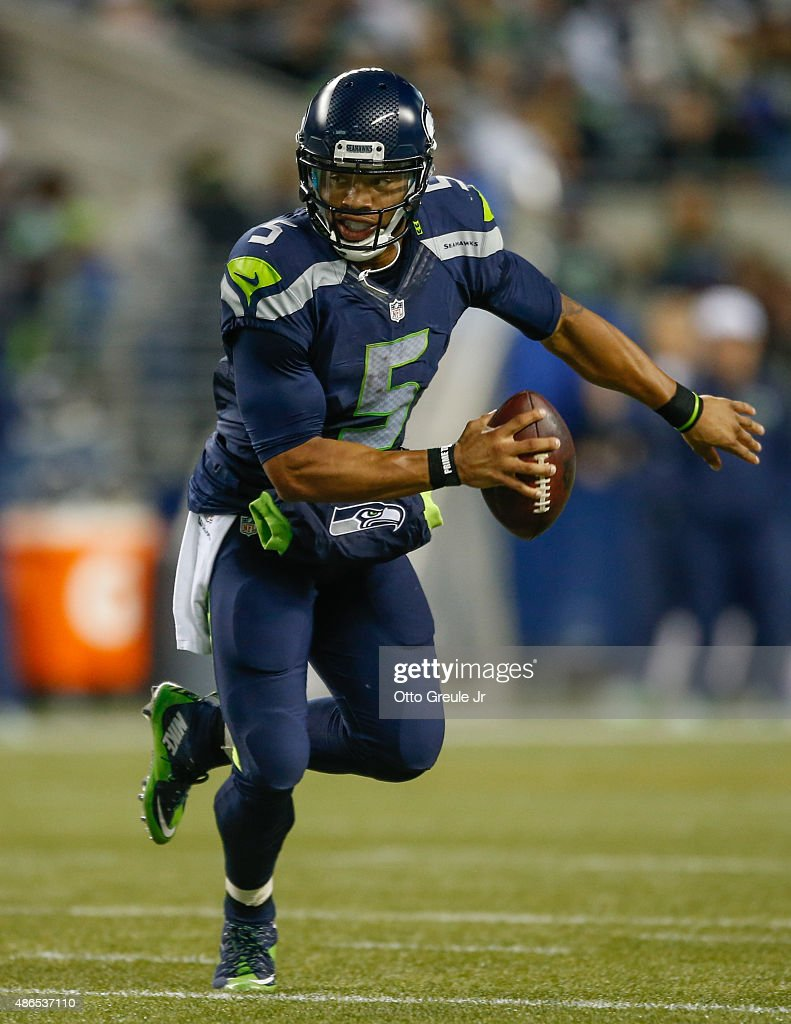 Quarterback bj daniels of the seattle seahawks rushes against the