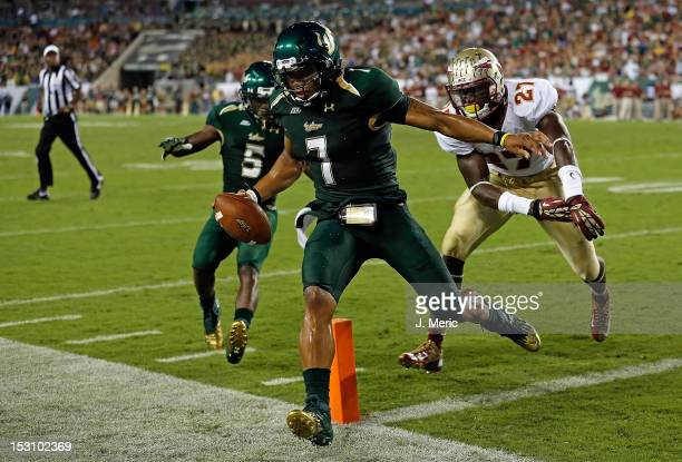 Quarterback BJ Daniels of the South Florida Bulls scores a touchdown against the Florida State Seminoles during the game at Raymond James Stadium on...