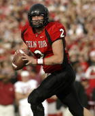Quarterback BJ Symons of the Texas Tech Red Raiders drops back to pass against the Oklahoma Sooners at Jones SBC Stadium on November 22 2003 in...