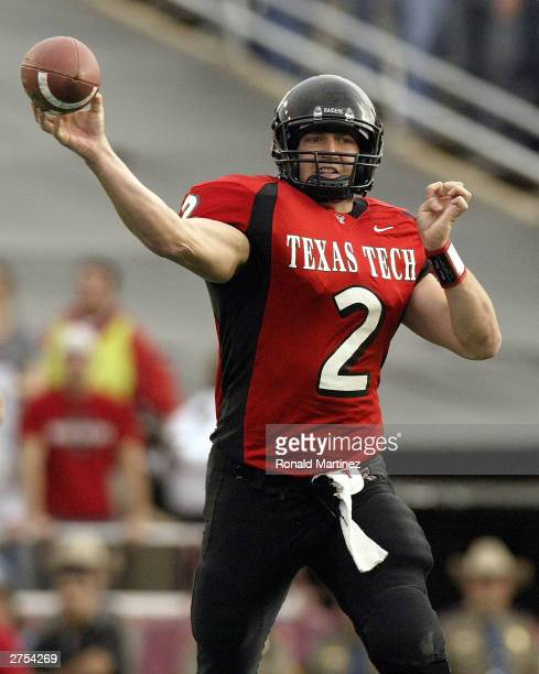 Quarterback BJ Symons of the Texas Tech Red Raiders drops back to pass against the Oklahoma Sooners on November 22 2003 at Jones SBC Stadium in...