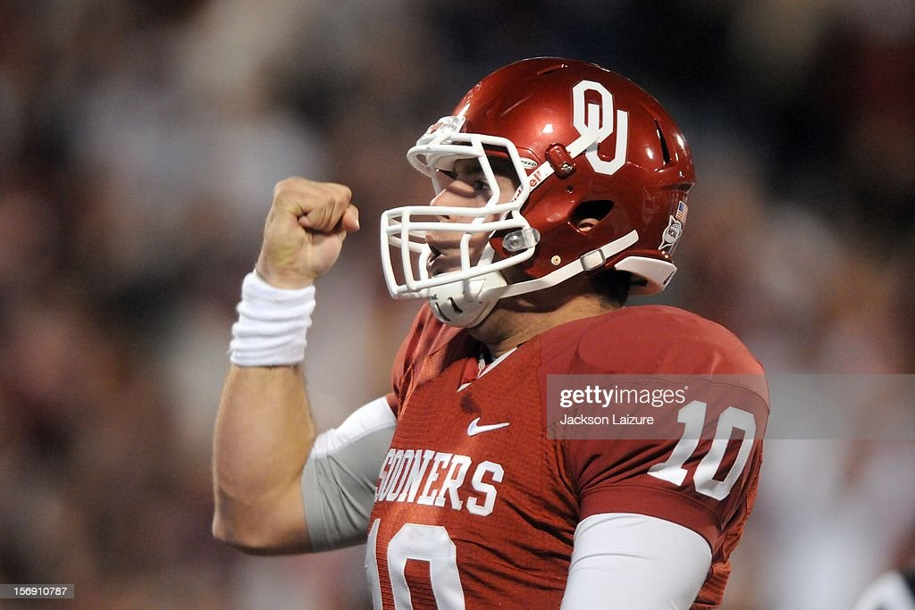 Quarterback Blake Bell #10 of the Oklahoma Sooners celebrates a game-tying touchdown in the fourth quarter against the Oklahoma State Cowboys on November 24, 2012 at The Gaylord Family Oklahoma Memorial Stadium in Norman, Oklahoma.