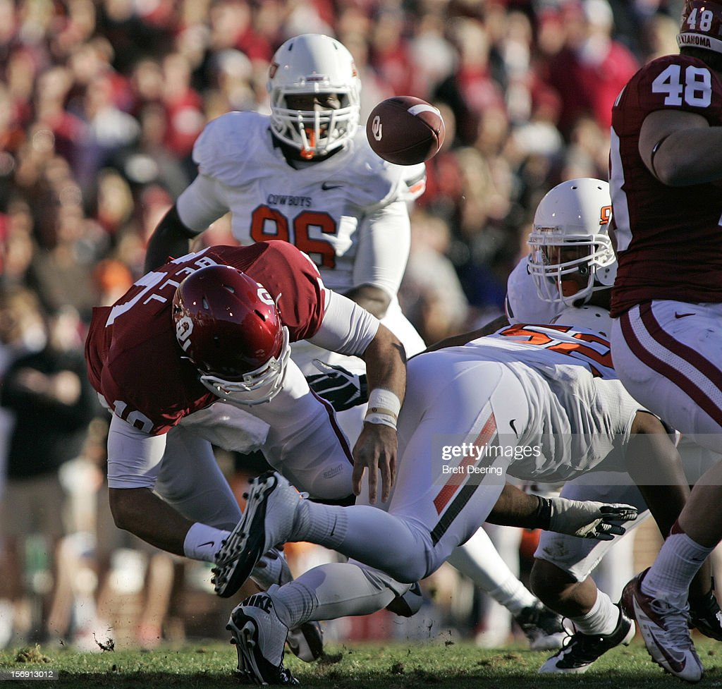 Quarterback Blake Bell #10 of the Oklahoma Sooners fumbles the ball against the Oklahoma State Cowboys November 24, 2012 at Gaylord Family-Oklahoma Memorial Stadium in Norman, Oklahoma. Oklahoma defeated Oklahoma State 51-48 in overtime.