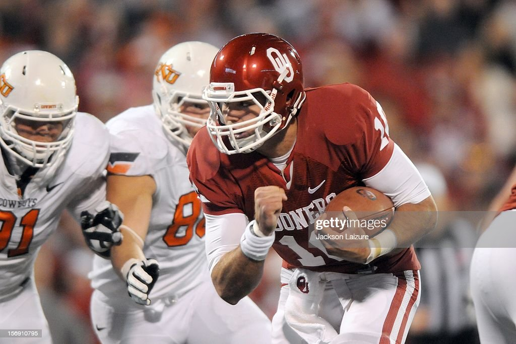 Quarterback Blake Bell #10 of the Oklahoma Sooners scores a game-tying touchdown in the fourth quarter against the Oklahoma State Cowboys on November 24, 2012 at The Gaylord Family Oklahoma Memorial Stadium in Norman, Oklahoma.