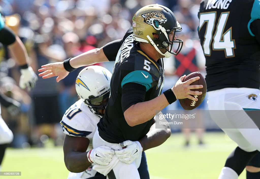 Quarterback Blake Bortles of the Jacksonville Jaguars is tackled by defensive lineman Ricardo Mathews of the San Diego Chargers at Qualcomm Stadium...