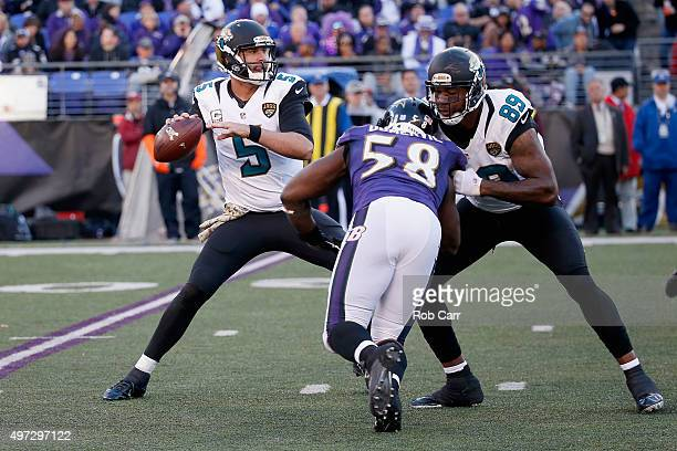 Quarterback Blake Bortles of the Jacksonville Jaguars looks to pass as Marcedes Lewis blocks Elvis Dumervil of the Baltimore Ravens in the second...