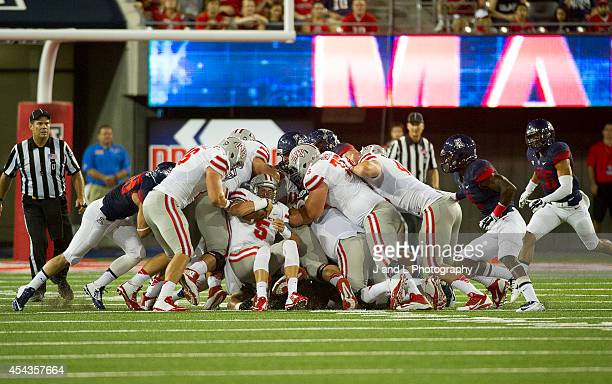 Quarterback Blake Decker of the UNLV Rebels pushes the pile on a 4th and short but came up short in 1st quarter at Arizona Stadium on August 29 2014...