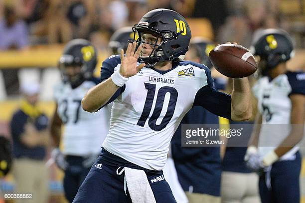 Quarterback Blake Kemp of the Northern Arizona Lumberjacks throws the football during warm ups prior to the game against the Arizona State Sun Devils...